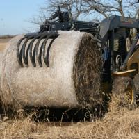 round hay bale lifted by grapple