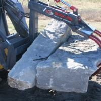 grapple carrying quarried stone