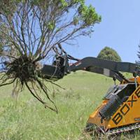Boxer skid steer pulls brush with Jawz